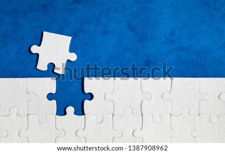 Jigsaw puzzle with missing piece. Missing puzzle pieces. Concept image of unfinished task. Completing final task, missing jigsaw puzzle pieces and business concept with a puzzle piece missing. #1387908962