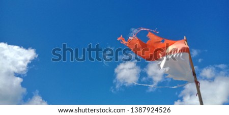 Old National flag with blue sky background in Geli Gede island, Indonesia  #1387924526