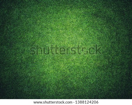 Artificial grass background with copy space.Green fake lawn.wallpaper for text and picture.green texture.artificial turf.The surface is made of synthetic fibers.Made from Polyethylene or polypropylene