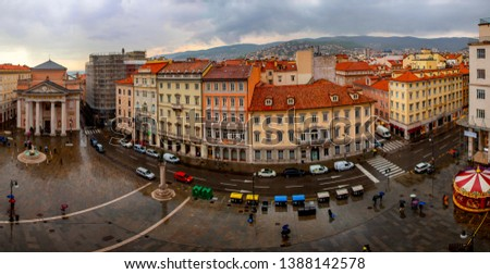 Trieste Italy April 12 2019: Red roof tops of the city in rain. #1388142578