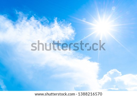 The blue summer sky with white fluffy clouds. Photo from window on the airplane. Royalty-Free Stock Photo #1388216570
