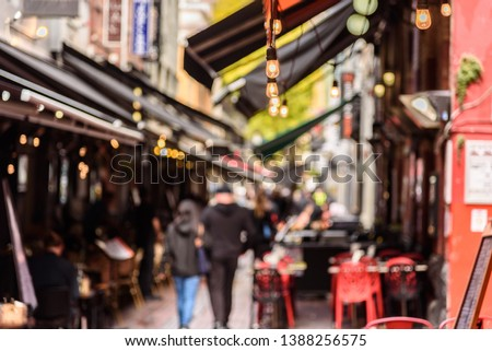 Hardware Lane in Melbourne, Australia is a popular tourist area filled with cafes and restaurants featuring al fresco dining. #1388256575