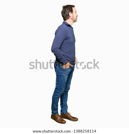 Middle age handsome man wearing a sweater looking to side, relax profile pose with natural face with confident smile. #1388258114