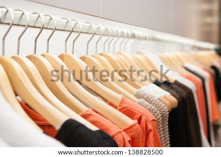 Clothes hang on a shelf in a designer clothes store in Melbourne, Australia Royalty-Free Stock Photo #138828500