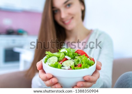 Healthy vegan woman holding a bowl of fresh vegetable salad. Balanced organic diet and clean eating. Healthy lifestyle #1388350904