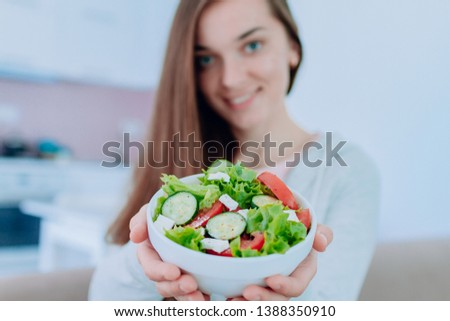 Healthy vegan woman holding a bowl of fresh vegetable salad. Balanced organic diet and clean eating. Healthy lifestyle #1388350910
