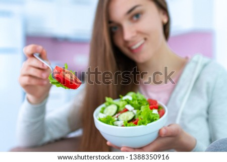 Portrait of smiling happy healthy woman eating fresh vegetable salad at home. Balanced diet and fitness eating. Clean and control food. Healthy lifestyle #1388350916