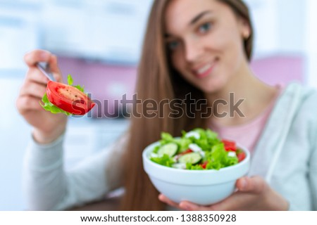 Portrait of young happy healthy woman eating fresh vegetable salad at home. Balanced diet and fitness eating. Clean and control food. Healthy lifestyle #1388350928