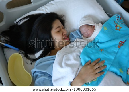 woman mother looking a cute baby newborn sleeping with love #1388381855