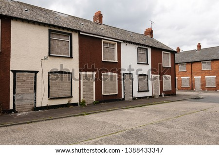 Two rows of derelict houses Royalty-Free Stock Photo #1388433347