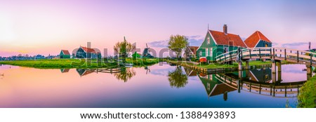 Beautiful Dutch scenery panorama of Zaanse Schans windmill village in Netherlands  #1388493893
