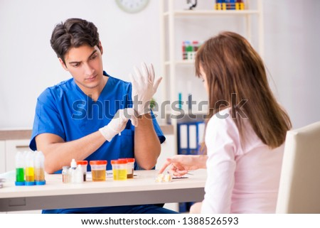 Patient visiting doctor for urine test #1388526593