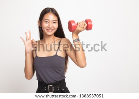 Healthy Asian woman show OK with dumbbells on white background #1388537051