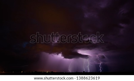 beautiful landscape with evening sky and big dark storm clouds and lightning above the ground #1388623619