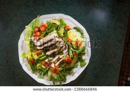 Dinner salad with chicken, avocado, asparagus, tomato, and red pepper #1388666846