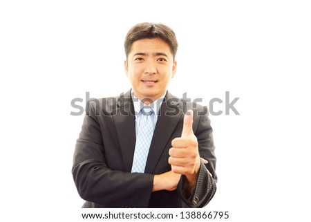 Happy business man showing thumbs up sign #138866795