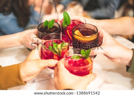 Friends toasting with sangria in a Spanish restaurant #1388691542
