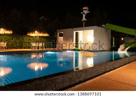 Beautiful blue water at night ,swimming pool for background. #1388697101