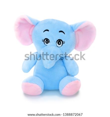 Elephant plushie doll isolated on white background with shadow reflection. Elephant plush stuffed puppet on white backdrop. Jumbo plushie toy. Colored stuffed elephant toy. Blue and pink elephant. #1388872067