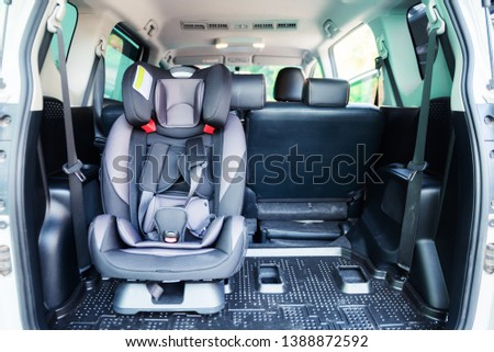 Car seat setting in car. Child transportation safety #1388872592
