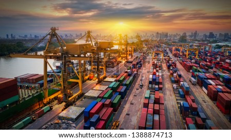 Logistics and transportation of Container Cargo ship and Cargo plane with working crane bridge in shipyard at sunrise, logistic import export and transport industry background #1388874713
