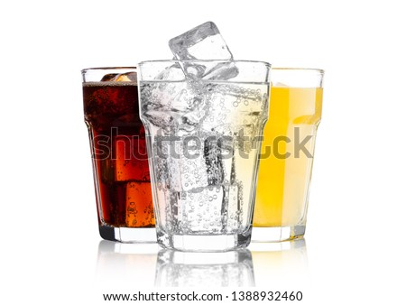 Glasses of cola and orange soda drink and lemonade sparkling water on white background with ice cubes Royalty-Free Stock Photo #1388932460