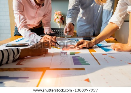 Businesspeople analyzing investment graph meeting brainstorming and discussing plan in meeting room, investment concept Royalty-Free Stock Photo #1388997959