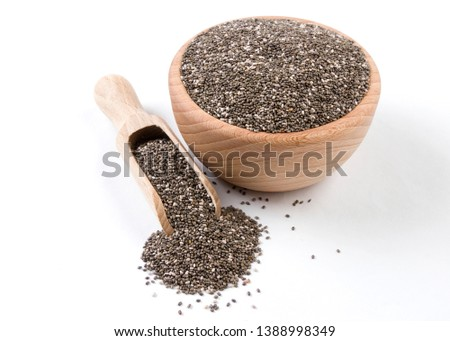 chia seeds in wooden bowl and scoop isolated on white background. Spices and food ingredients. #1388998349