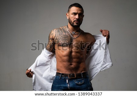 confidence charisma. muscular macho man with athletic body. sport and fitness, health. sexy abs of tattoo man. male fashion. brutal sportsman torso. steroids. sexy muscular body. muscular man. #1389043337