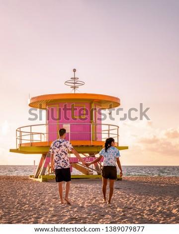 couple on the beach at Miami beach, life guard hut Miami beach Florida #1389079877