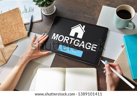 Mortgage online application form on device screen. Business and finance concept. #1389101411