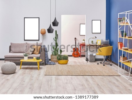 Modern living room style with white and blue wall background, yellow detail furniture and grey sofa, decorative lamp. #1389177389