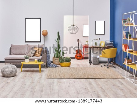Modern living room style with white and blue wall background, yellow detail furniture and grey sofa, decorative lamp. #1389177443