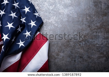 An Overhead View Of American Flag On Dark Concrete Background #1389187892