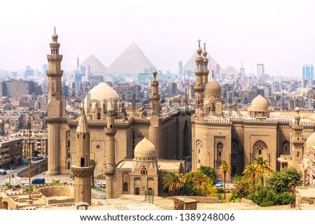 The Mosque-Madrassa of Sultan Hassan and the Pyramids in the background, Cairo, Egypt #1389248006