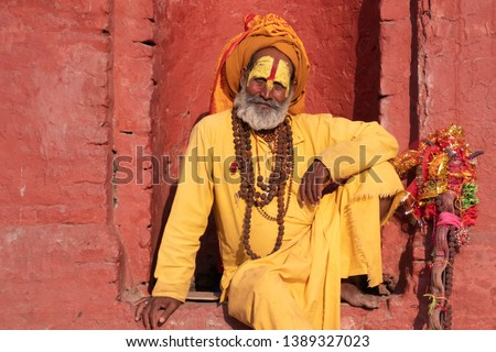 Kathmandu Sadhu men holy person in hinduism with traditional painted face at Pashupatinath Temple of Kathmandu - Non English word in image is prayer words #1389327023