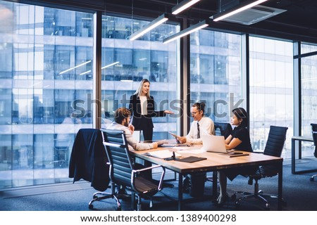 Professional financial experts collaborating during brainstorming meeting listening information from clever female director, businesswoman providing information to corporate workers of company #1389400298