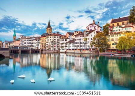 Scenic view of historic Zurich city center with famous Fraumunster and Grossmunster Churches and river Limmat at Lake Zurich, Canton of Zurich, Switzerland #1389451511