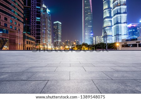 Shanghai modern commercial office buildings and square floor at night #1389548075