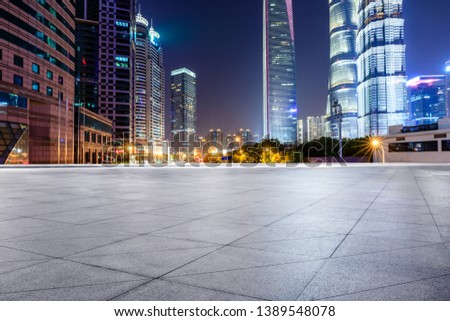 Shanghai modern commercial office buildings and square floor at night #1389548078