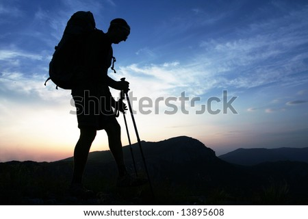 Backpackers silhouette on sunset #13895608