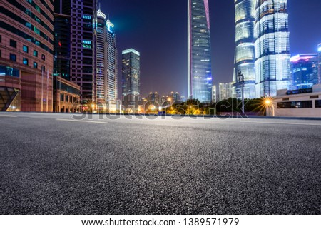Shanghai modern commercial office buildings and empty asphalt highway at night #1389571979