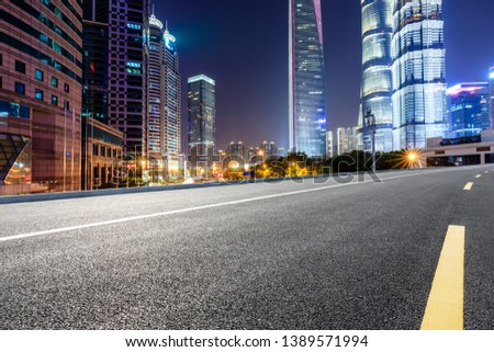 Shanghai modern commercial office buildings and empty asphalt highway at night #1389571994