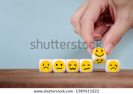 Hand Changing with smile emoticon icons  face on Wooden Cube,hand flipping unhappy turning to happy symbol #1389611822