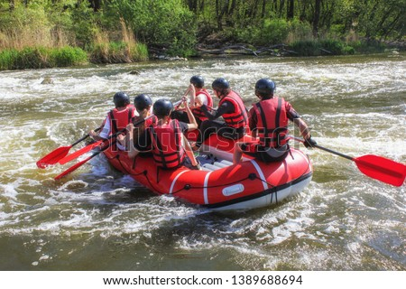 Rafting team , summer extreme water sport.  Group of people in a rafting boat, beautiful adrenaline ride down the Pacuare River,  Costa Rica. #1389688694