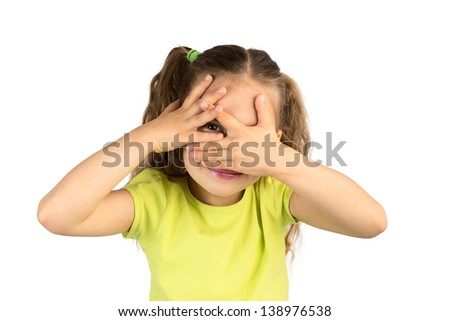 Cute Little Girl Covering Her Eyes While Watching Through the Gap in Fingers, Isolated #138976538
