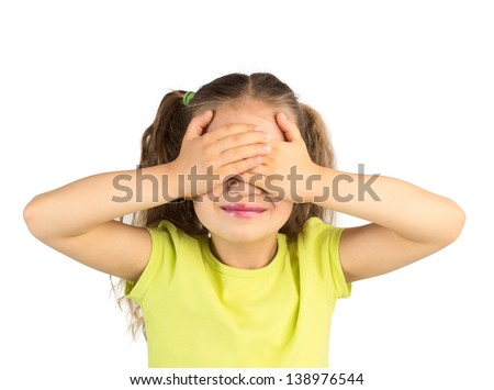 Cute Smiling Little Girl Covering Her Eyes with Her Hands, Isolated #138976544