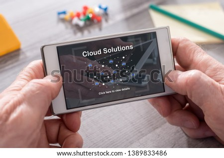 Cloud solutions concept on mobile phone #1389833486