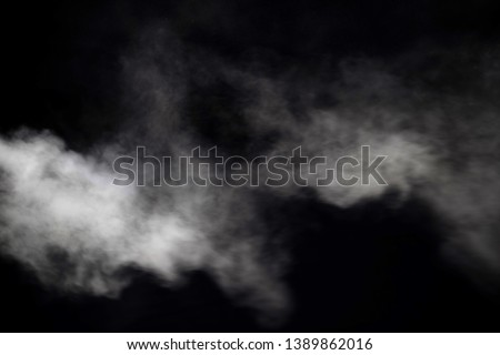 smoke blow isolated on dark background Royalty-Free Stock Photo #1389862016