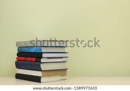 Stack of books on shelf #1389971633